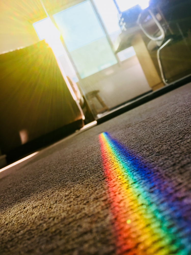 image of a cleaned carpet with rainbow lighting