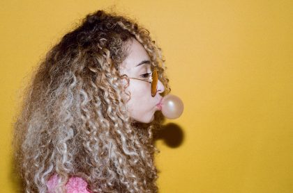 Image of girl with chewing gum for the removing chewing gum top tips